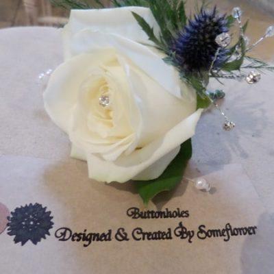 Blue Flower Arrangement Buttohole